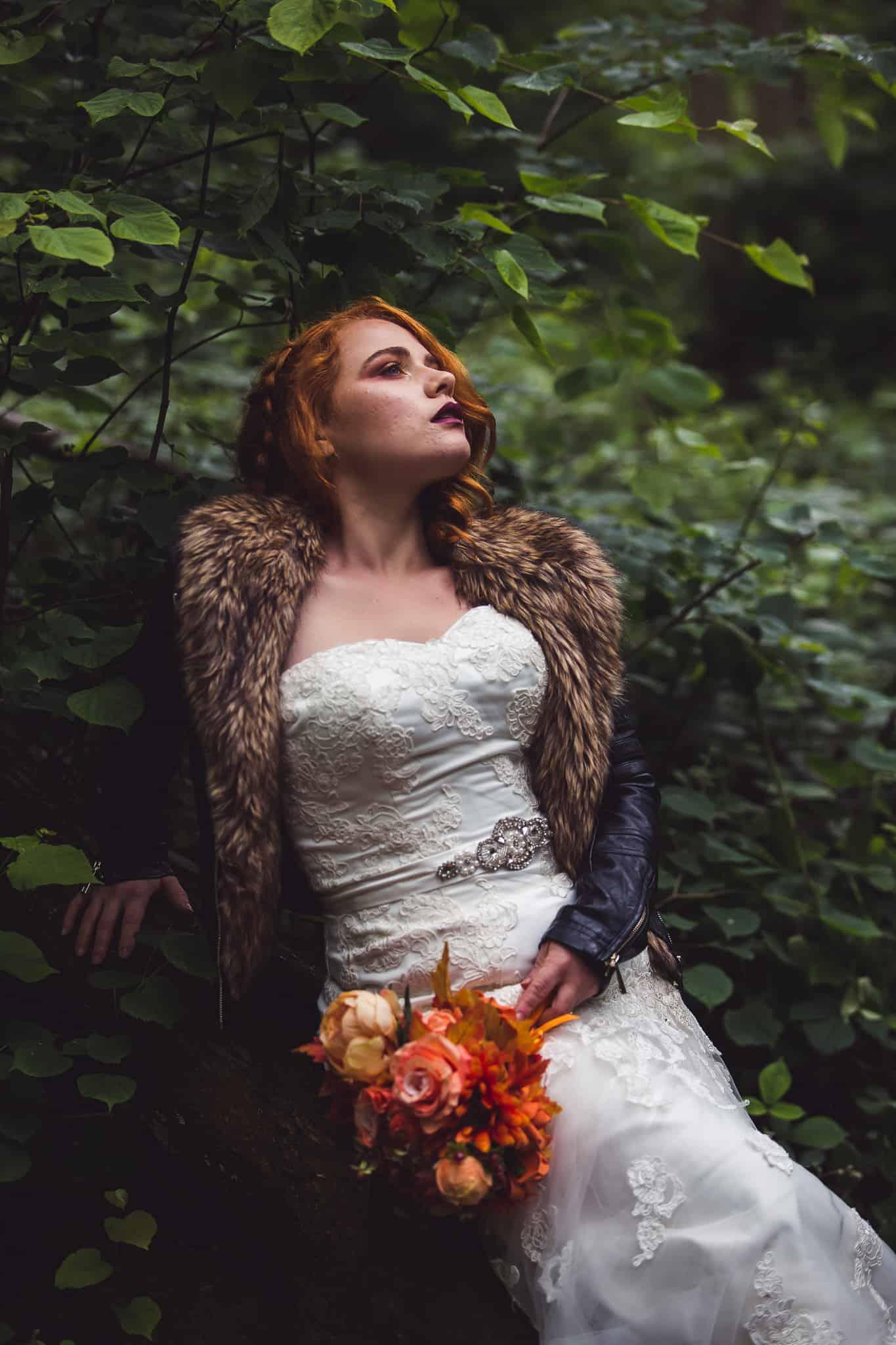outdoor wedding bride rock chick leather jacket autumnal orange photography Katie Mortimore