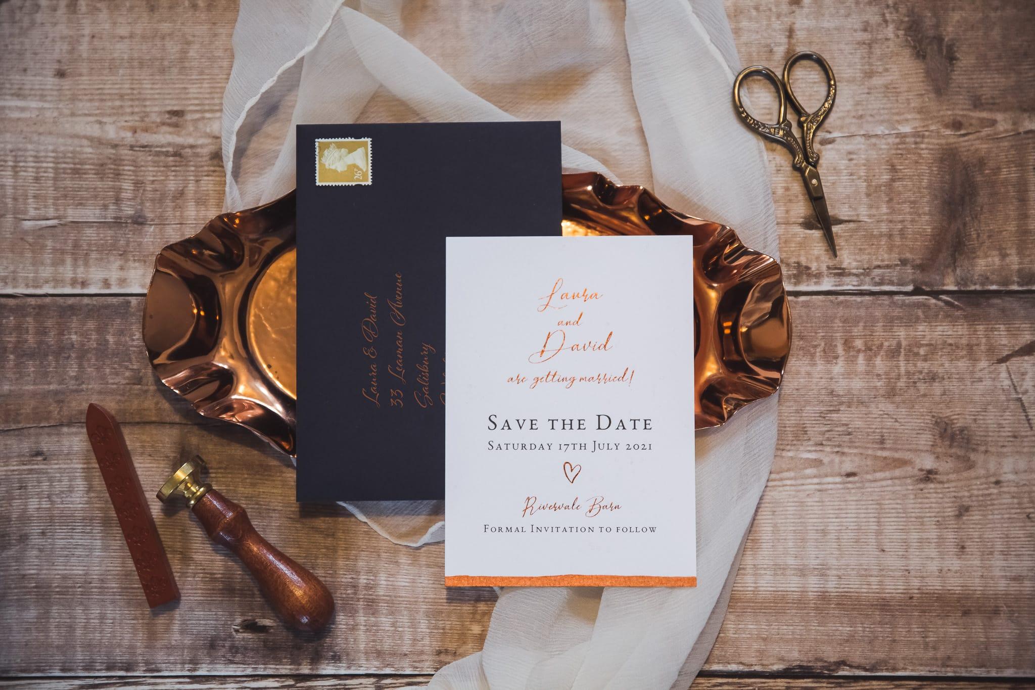 bronze accented wedding invitation