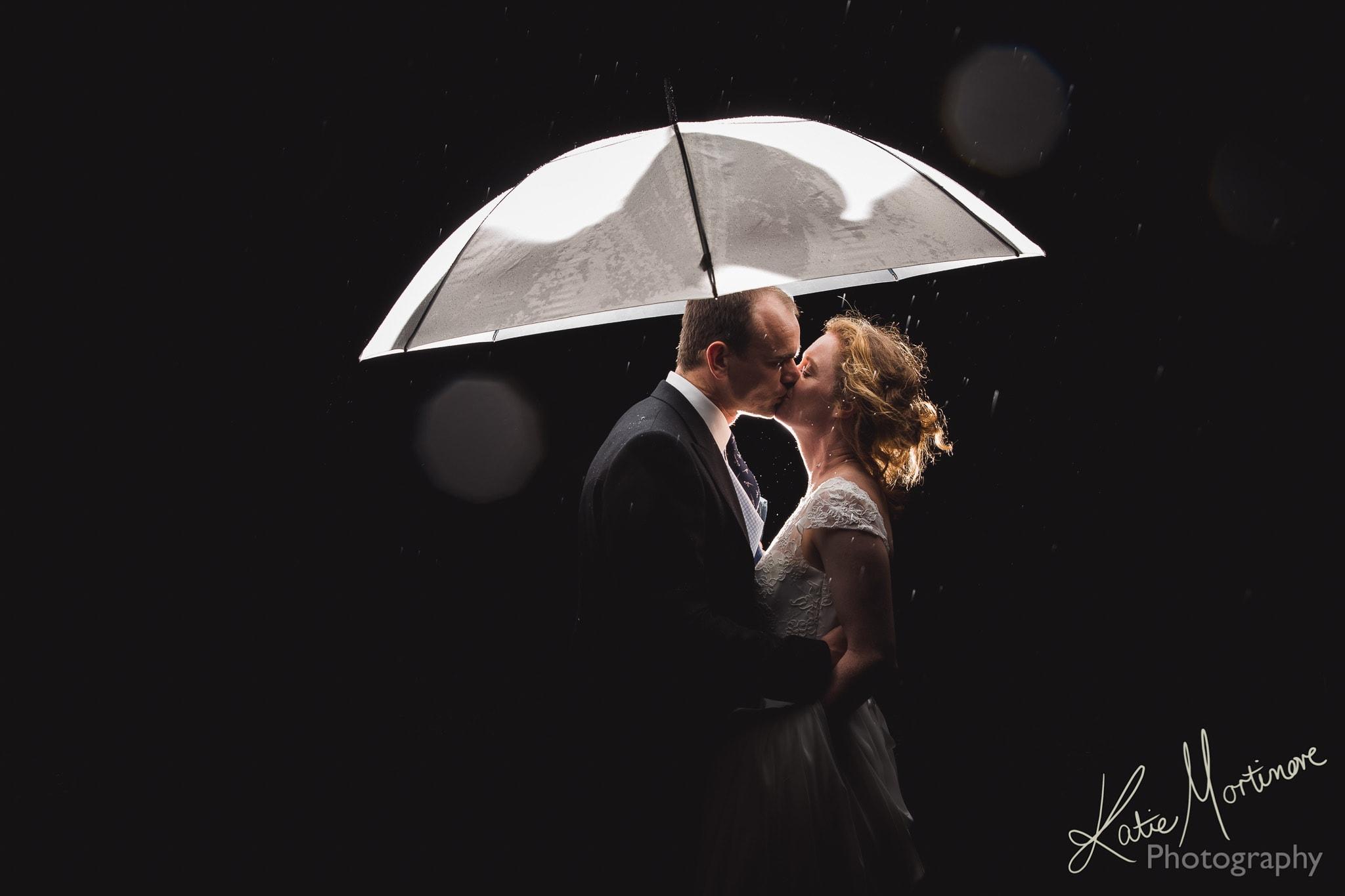wet rain wedding photographer